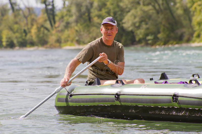 Download Middle aged man rafting stock image. Image of middle - 21404779