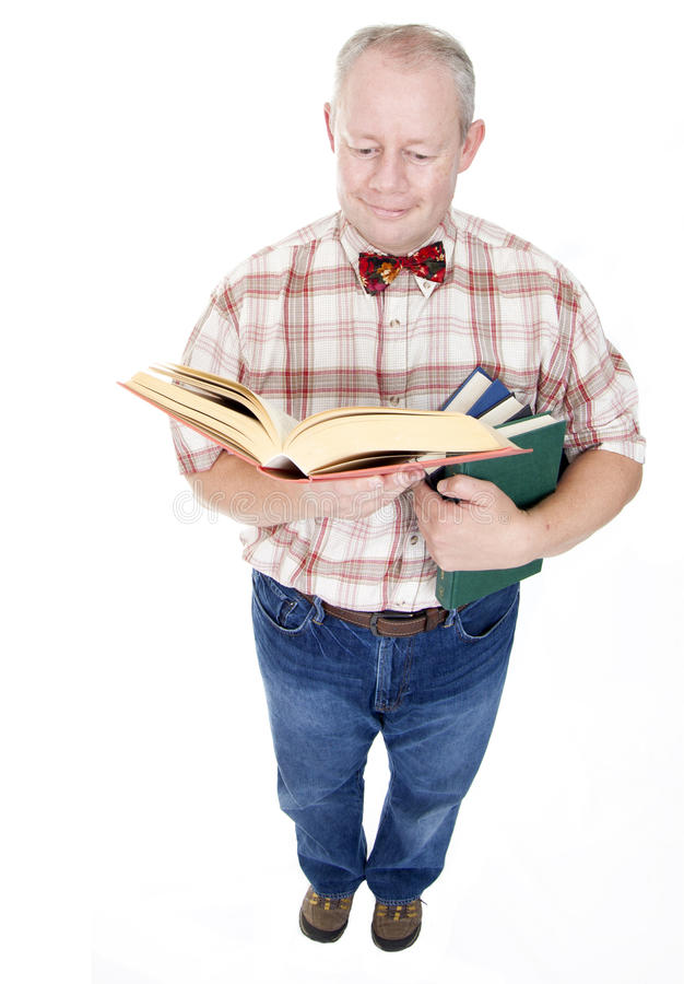 Middle Aged Man Reading A Book stock photography