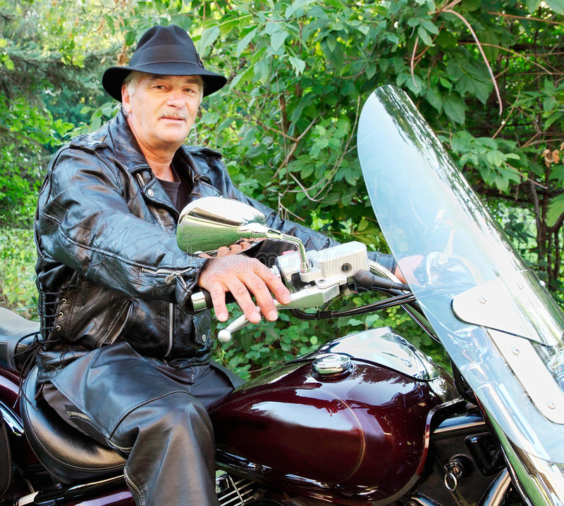 Download Middle-Aged Man Riding Motorcycle Stock Photo - Image: 10887552