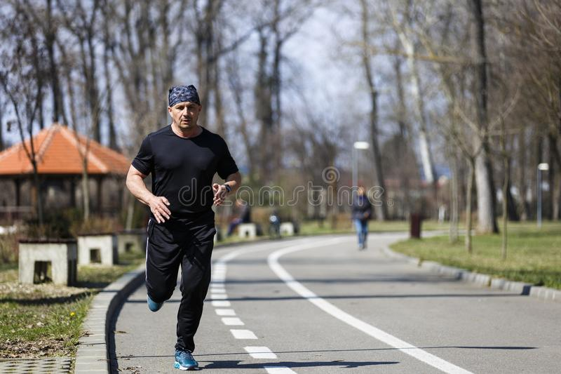 A middle-aged man running royalty free stock photo
