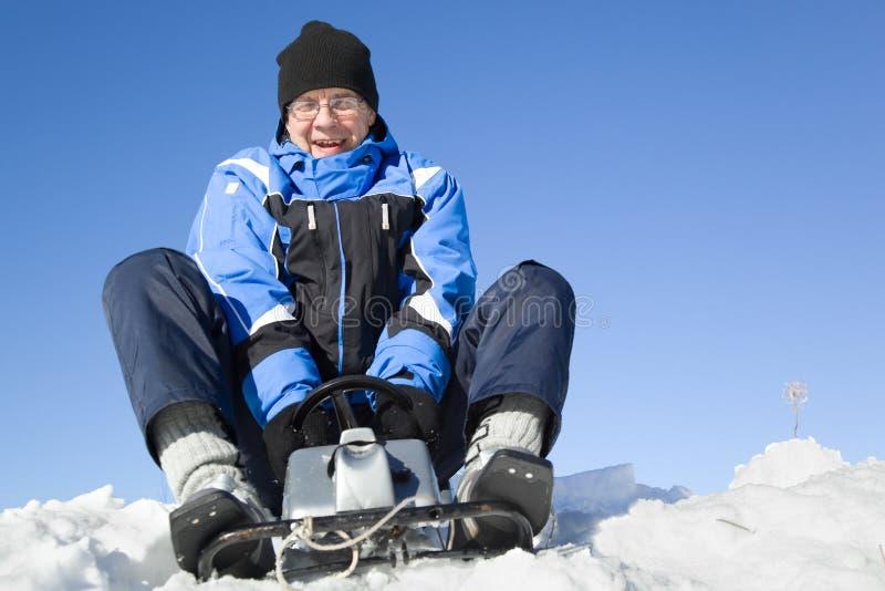 Middle-aged man sledding