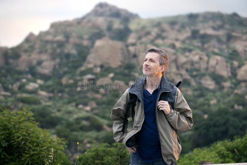 Man Enjoying Nature While Hiking on Vacation royalty free stock images