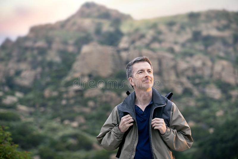Man Enjoying Nature While Hiking on Vacation stock photography