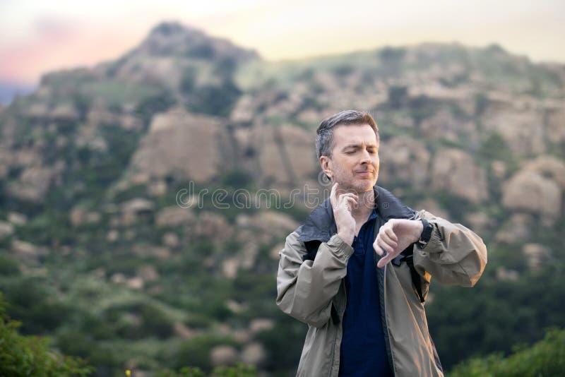 Man Enjoying Nature While Hiking on Vacation stock photo