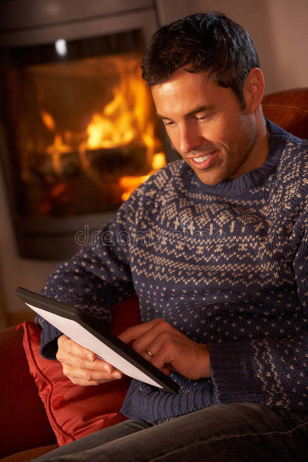 Download Middle Aged Man Using Tablet Computer Stock Image - Image: 24424247