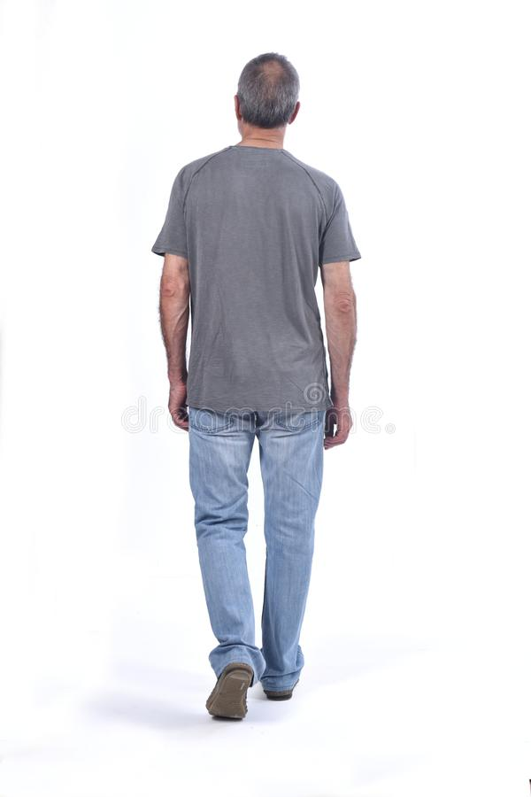 Middle-aged man walking white background stock photography