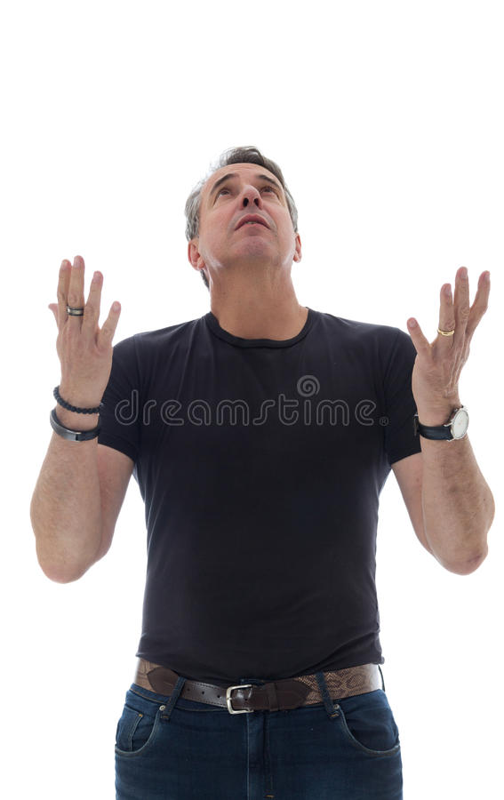 Middle-aged man wears black t-shirt. He thanks and looks up. royalty free stock photos