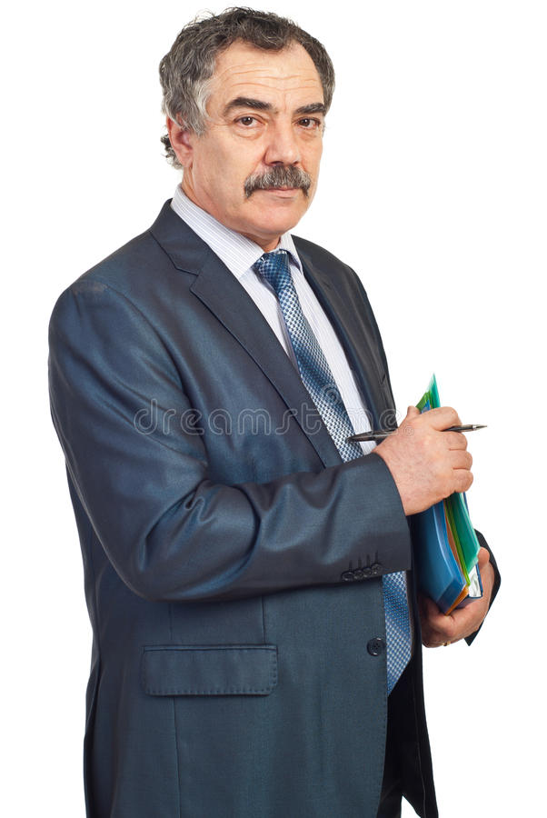 Middle aged manager with folders. Middle aged manager holding folders and pencil isolated on white background royalty free stock images
