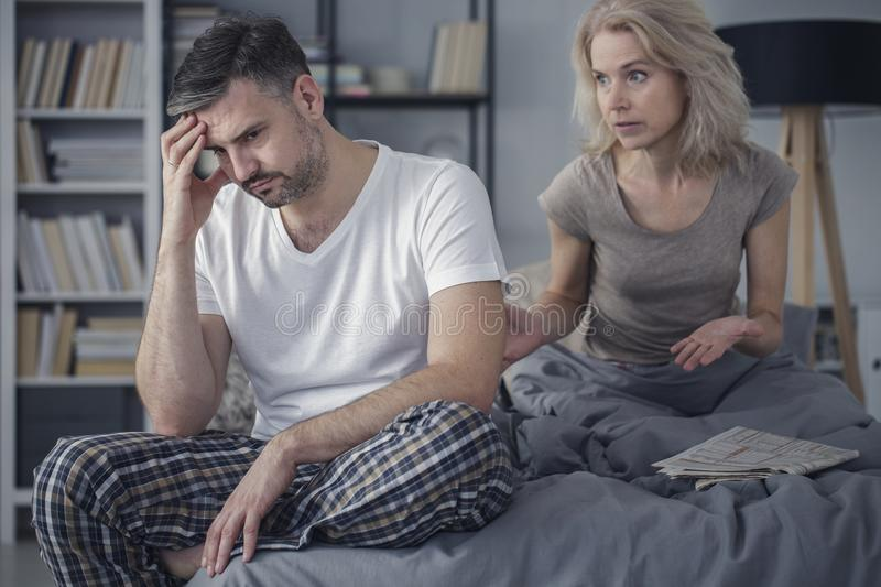 Married couple arguing in bedroom. Middle-aged married couple having problems and arguing about their relationship in the bedroom stock photos