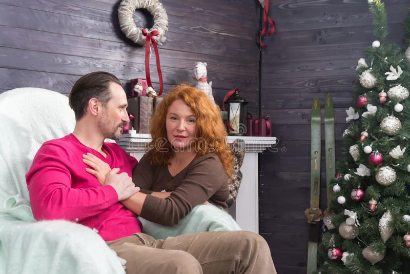 Calm woman putting one hand on the chest of her husband and looking at you stock photo