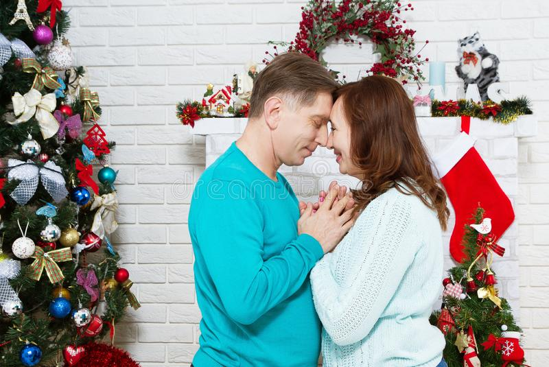 Middle aged romantic couple is having fun in living room before Christmas. Enjoying spending time together in New Year stock image