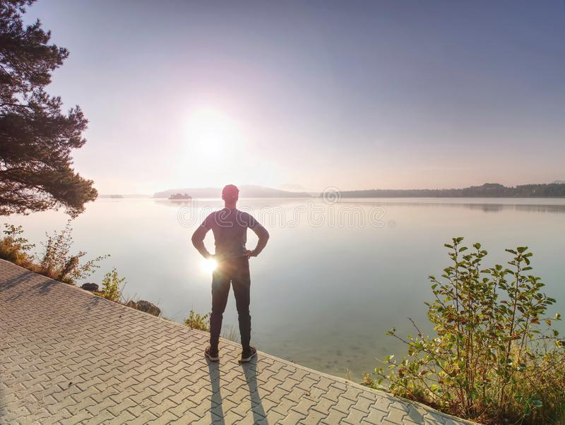 Middle aged runner stop for breath. Sportsman takes a break royalty free stock photography