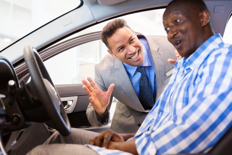 Middle aged salesman customer stock image