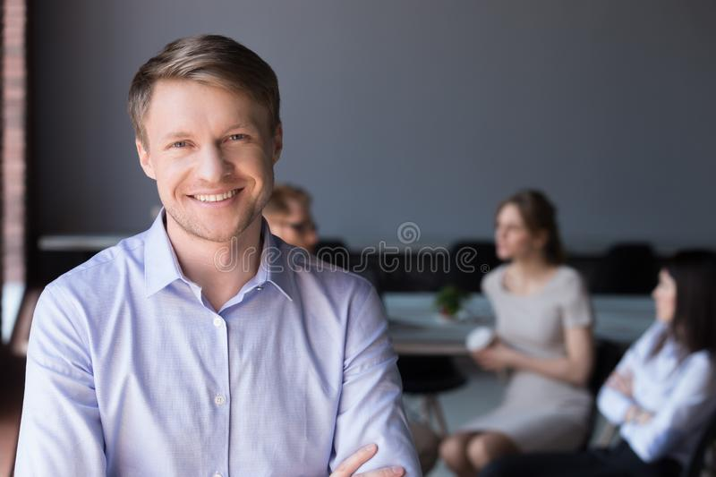 Middle-aged smiling company ceo or successful businessman lookin stock photo