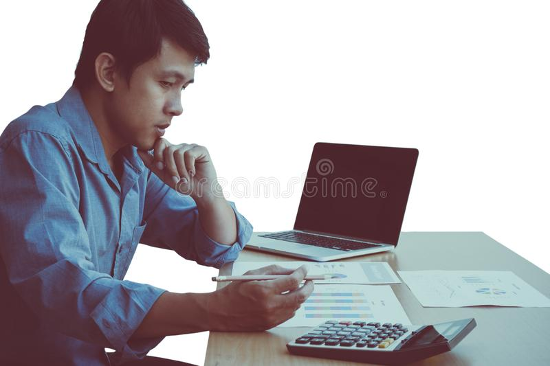 Middle aged thinking businessman working on laptop and checking the report stock images