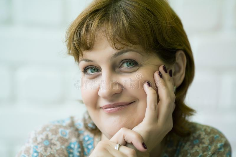 Middle aged woman closeup in cafe. Smiling royalty free stock photo