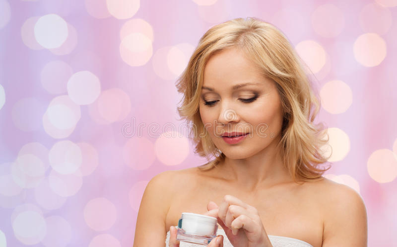 Middle aged woman with cream jar stock photography