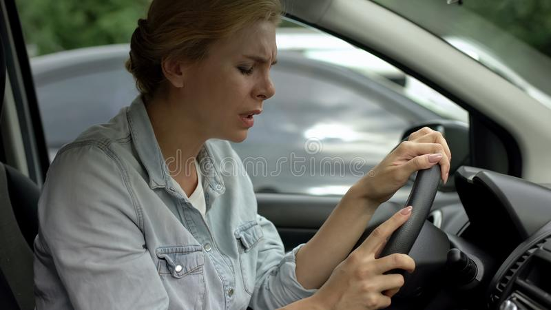 Middle-aged woman driving car suddenly feeling dizziness, risk of faint, health. Stock photo royalty free stock photos