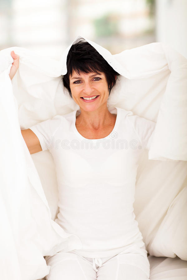 Download Middle aged woman duvet stock photo. Image of cute, bright - 29320310