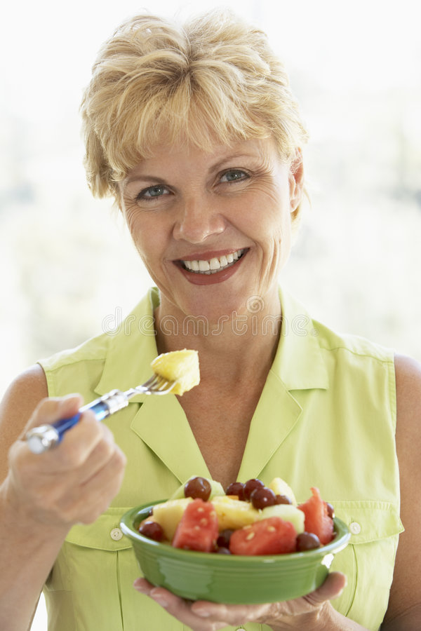 Download Middle Aged Woman Eating Fresh Fruit Salad Stock Image - Image: 7875387