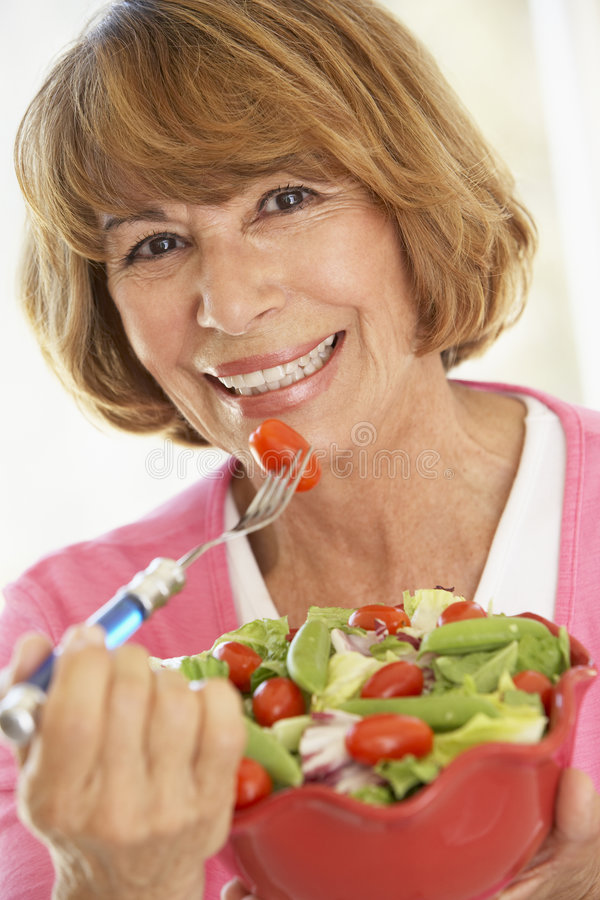 Download Middle Aged Woman Eating A Fresh Green Salad Stock Photo - Image: 7875970