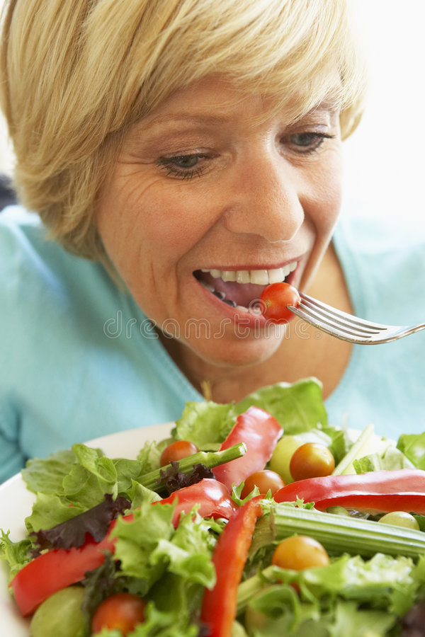 Download Middle Aged Woman Eating Healthy Salad Stock Photo - Image of fresh, food: 7871020