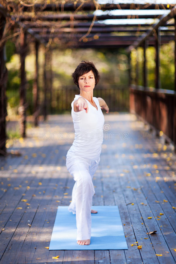 Middle aged woman exercise stock photos