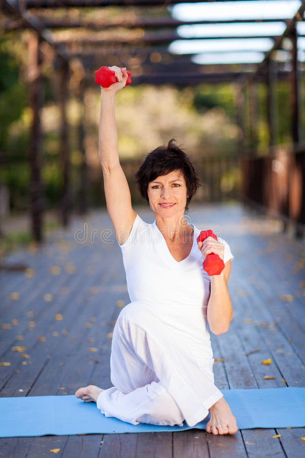 Middle aged woman exercise royalty free stock photography