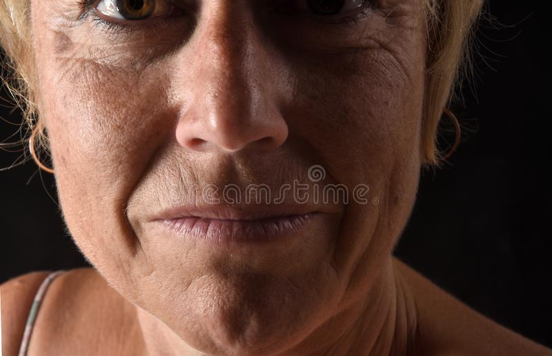 Middle aged woman face close-up royalty free stock images