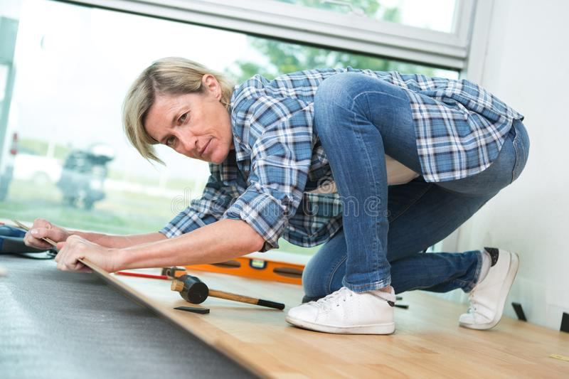 Middle aged woman fitting floor stock photo