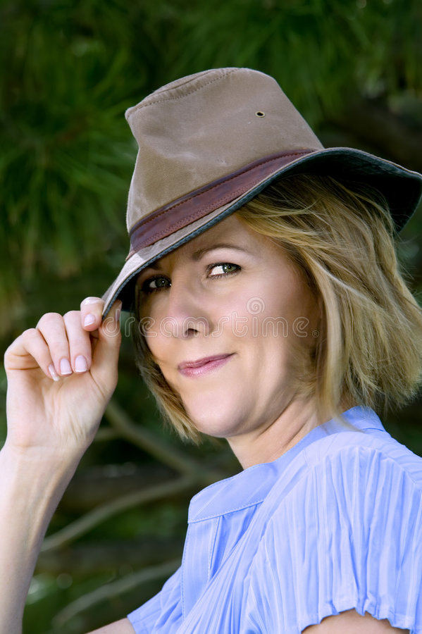 Middle-aged Woman With Hat Royalty Free Stock Images
