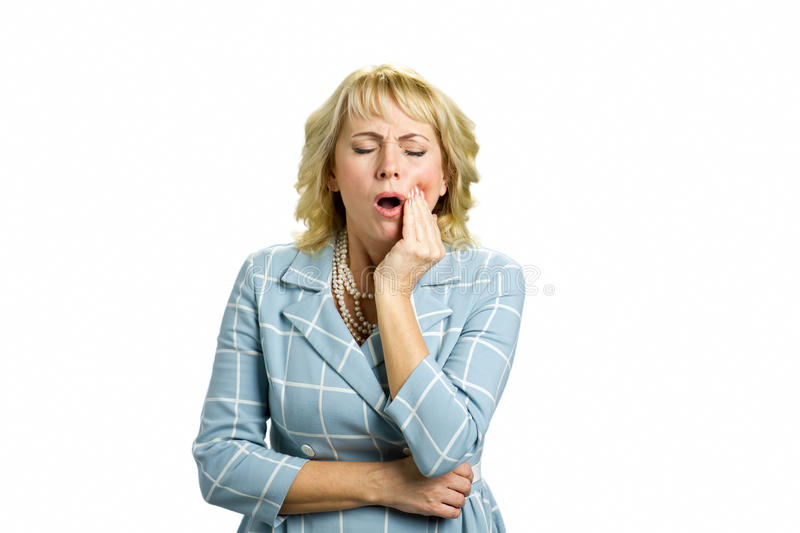 Middle aged woman having terrible tooth pain. royalty free stock image