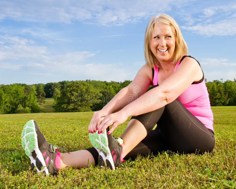 Download Middle-aged Woman In Her 40s Stretching Stock Photo - Image: 25457726