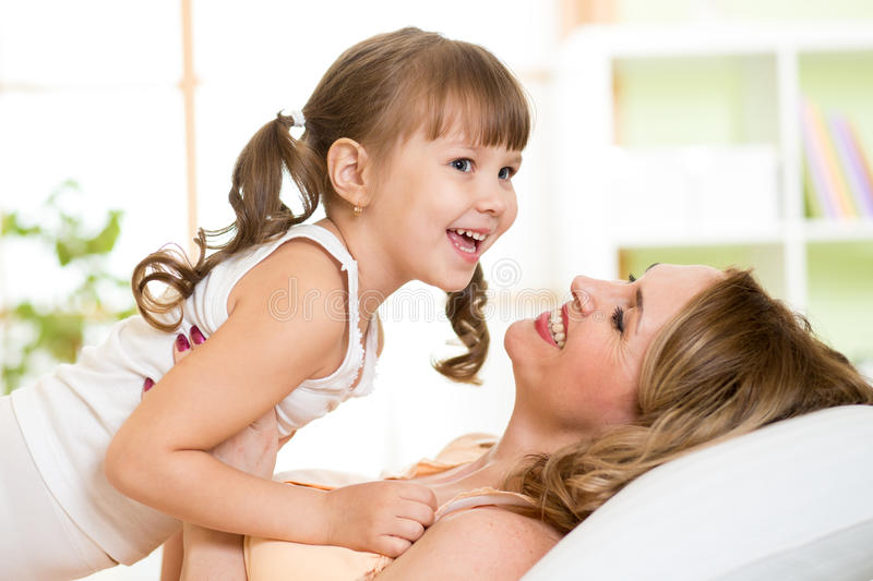 Download Middle-aged Woman With Her Daughter Child Play And Stock Image - Image of interior, healthy: 54102071
