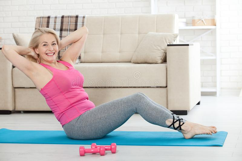 Middle-aged woman in her 50s stretching for exercise stock images