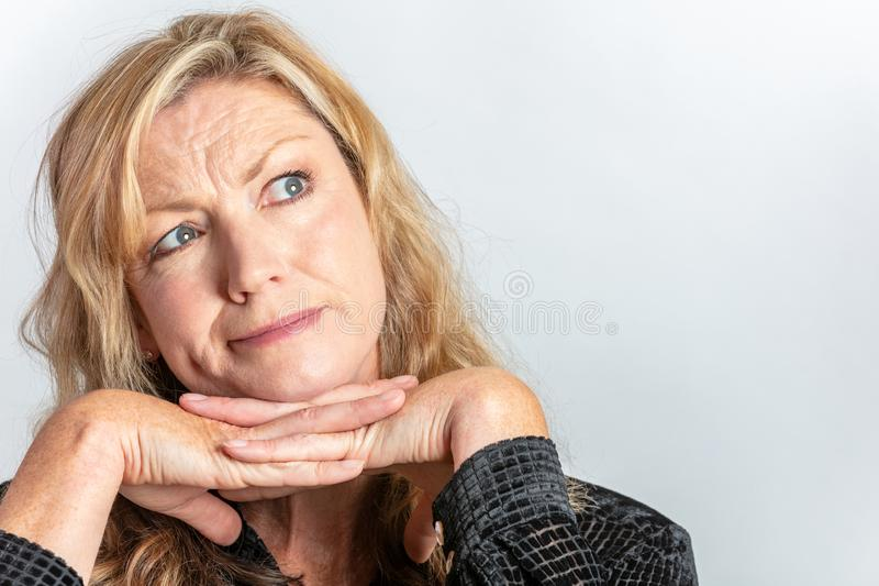 Middle Aged Woman Looking Inquisitive or Questioning stock photo