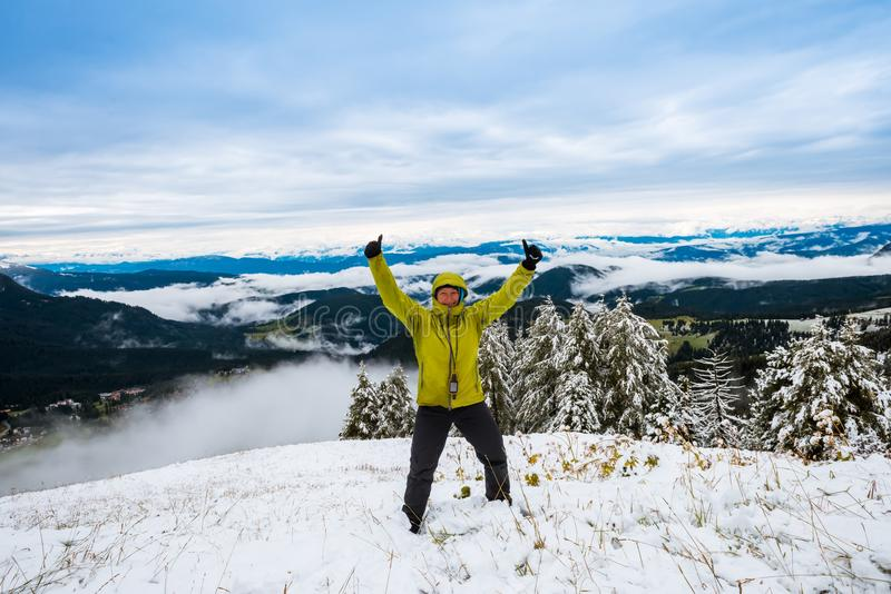 Middle aged woman on mountain peak against beautiful mountains Travel Success royalty free stock photos