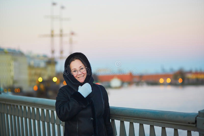 Middle aged woman on the Neva embankment in St. Petersburg, Russia. Beautiful middle aged woman on the Neva embankment in St. Petersburg, Russia stock photography