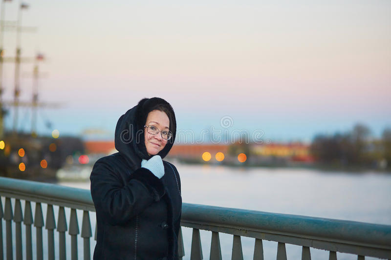 Middle aged woman on the Neva embankment in St. Petersburg, Russia. Beautiful middle aged woman on the Neva embankment in St. Petersburg, Russia stock photos