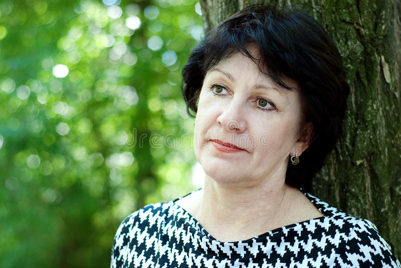 Middle-aged woman outdoors royalty free stock photo