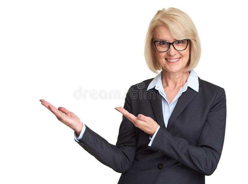 Middle aged woman pointing hands at copy space royalty free stock photography