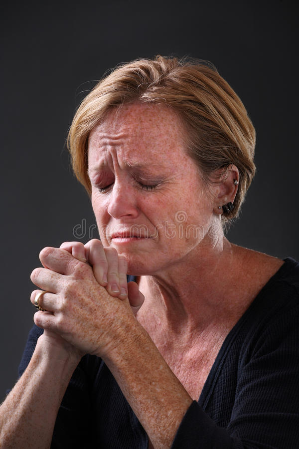 Download Middle aged woman praying stock photo. Image of head - 17769050