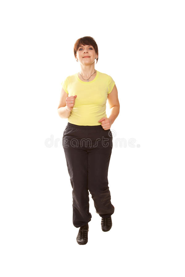 Middle-aged woman running jogging. Sports healthy lifestyle. Isolated on white background royalty free stock image