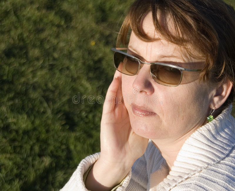 Middle aged woman with shades stock photos