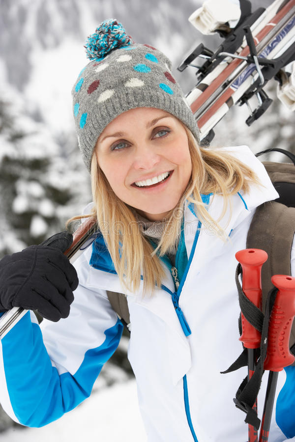 Download Middle Aged Woman On Ski Holiday In Mountains Stock Image - Image of forties, france: 25643969