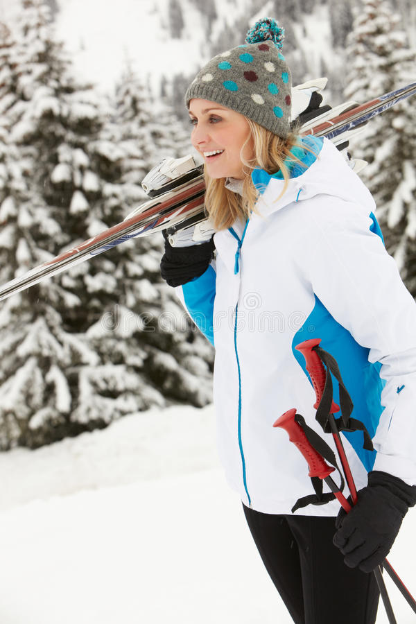 Download Middle Aged Woman On Ski Holiday In Mountains Stock Photo - Image of alps, vacation: 25662546