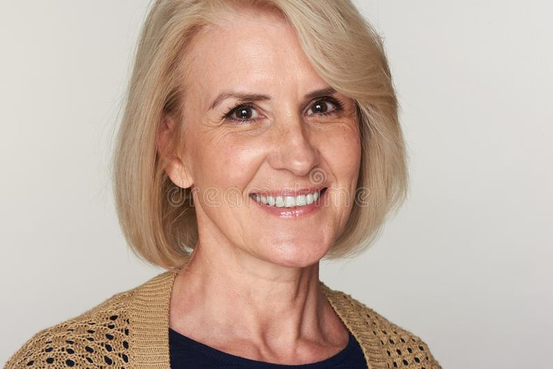 Middle aged woman smiling royalty free stock photos