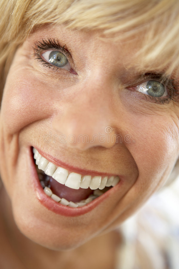 Download Middle Aged Woman Smiling Happily Stock Image - Image: 7883081
