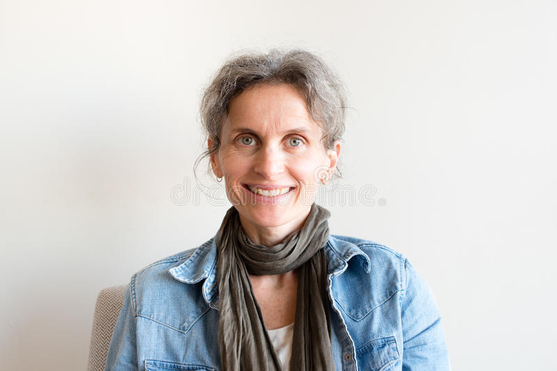 Middle aged woman smiling stock image