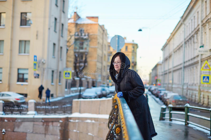 Middle aged woman in St. Petersburg. Beautiful middle aged woman on Moika embankment in St. Petersburg, Russia stock images
